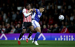Birmingham City's Che Adams, (right) battles for possession of the ball with Brentford's Romaine Sawyers