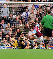 Paolo Di Canio (West Ham) scores the winning goal past Carlo Cudicini (Chelsea goalkeeper). West Ham United  v Chelsea. Upton Park. 3/5/2003. Credit : Colorsport/Andrew Cowie.