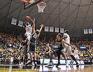 WICHITA, KS - NOVEMBER 14:  Forward Nick Wiggins #15 of the Wichita State Shockers drives to the basket against forward Tim Rusthoven #22 of the William & Mary Tribe during the first half on November 14, 2013 at Charles Koch Arena in Wichita, Kansas.  (Photo by Peter G. Aiken/Getty Images) *** Local Caption *** Nick Wiggins;Tim Rusthoven
