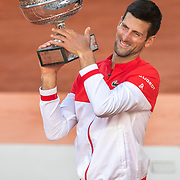 PARIS, FRANCE June 13.   Novak Djokovic of Serbia with the winners trophy after his victory against Stefanos Tsitsipas of Greece on Court Philippe-Chatrier during the final of the singles competition at the 2021 French Open Tennis Tournament at Roland Garros on June 13th 2021 in Paris, France. (Photo by Tim Clayton/Corbis via Getty Images)