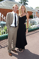 MR LUKE MARRIOT and LISA BUTCHER at the King George VI and The Queen Elizabeth Diamond Stakes sponsored by De Beers for the 33rd year held at Ascot Racecourse, Berkshire on July 24th 2004.