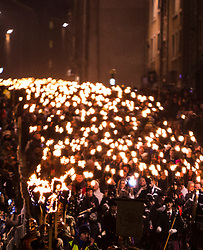 Edinburgh's Hogmanay celebrations start with the traditional torchlit procession. This year the route finishes outside the Scottish Parliament in  Holyrood where a word chosen by the young people of Scotland that makes them proud to live in the country is revealed by the thousands of torch bearers.<br /> <br /> Pictured: Torchlight Procession along the Canongate