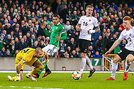 Northern Ireland forward Josh Magennis sees his shot at goal saved during the UEFA European 2020 Qualifier match between Northern Ireland and Estonia at National Football Stadium, Windsor Park, Northern Ireland on 21 March 2019.
