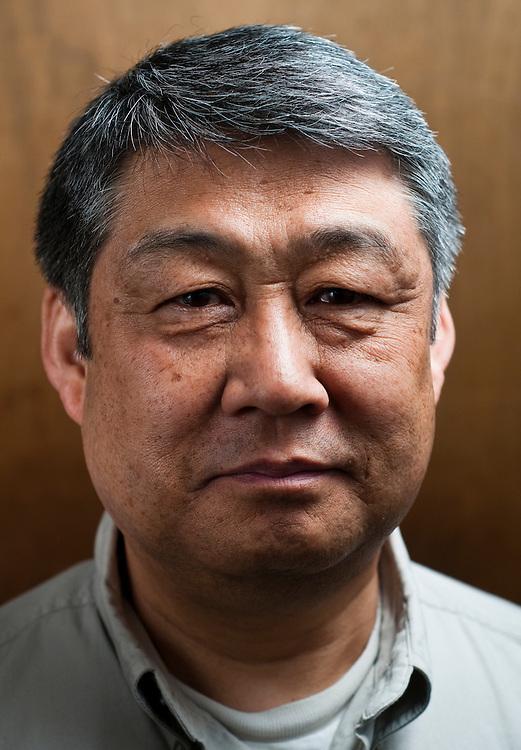 Matt Dixon | The Flint Journal..candidate mug of Jung Ho Kim