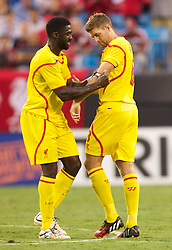 CHARLOTTE, USA - Saturday, August 2, 2014: Liverpool's Kolo Toure hands the captain's armband over to Steven Gerrard during the International Champions Cup Group B match against AC Milan at the Bank of America Stadium on day thirteen of the club's USA Tour. (Pic by Mark Davison/Propaganda)