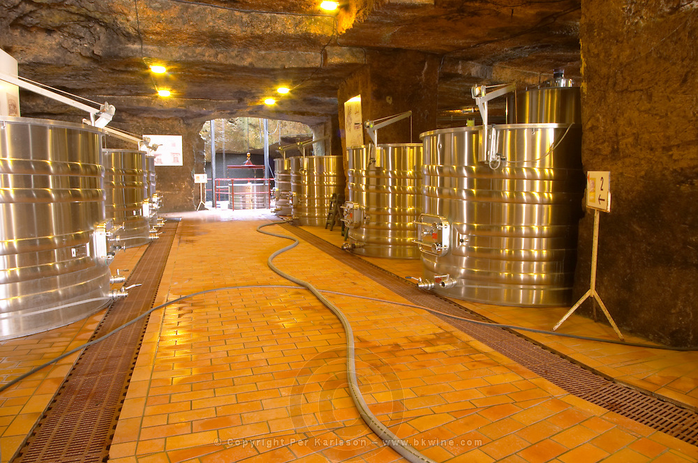 The underground winery and cellar in an old stone quarry, modern stainless steel fermentation vats Chateau Belair (Bel Air) 1er premier Grand Cru Classe Saint Emilion Bordeaux Gironde Aquitaine France