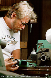 Arlen Ness working on a metal lathe in his Castro Valley home shop. Photograph ©1987 Michael Lichter