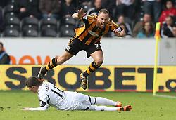 Swansea's Pablo Hernandez fouls Hull's David Meyler - Photo mandatory by-line: Matt Bunn/JMP - Tel: Mobile: 07966 386802 05/04/2014 - SPORT - FOOTBALL - KC Stadium - Hull - Hull City v Swansea City- Barclays Premiership