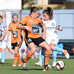 BRISBANE, AUSTRALIA - DECEMBER 4: Maddy Evans of the Roar and Lauren Barnes of the City compete for the ball during the round 5 Westfield W-League match between the Brisbane Roar and Melbourne City at AJ Kelly Field on December 4, 2016 in Brisbane, Australia. (Photo by Patrick Kearney/Brisbane Roar)
