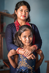 17 September 2018, Kavre district, Nepal: Six-year-old Saloni and her mother Samjhana Mijar are one of 15 Dalit households in Biruwa who have received LWF support to construct permanent houses and homes. The Lutheran World Federation World Service programme reaches communities far into the rural areas of Nepal. In the Kavre district, the programme runs a Post-Earthquake Rehabilitation and Livelihood Recovery Project. In the community of Biruwa, the LWF supports those most marginalized in Nepal society to construct earthquake-resilient houses for themselves.