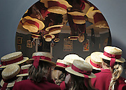 © Licensed to London News Pictures. 14/06/2012. London, UK A group of school girls wearing straw hats are reflected in an unnamed sculpture by Anish Kapoor. It is estimated to fetch between 400,000-600,000GBP. Photocall for Sotheby's June Contemporary Art Evening Auction. Photo credit : Stephen Simpson/LNP