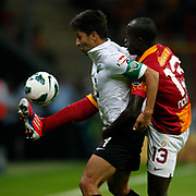 Galatasaray's Dany Nounkeu (R) and Akhisar Belediyespor's Emrah Eren during their Turkish Super League soccer match Galatasaray between Akhisar Belediyespor at the TT Arena at Seyrantepe in Istanbul Turkey on Sunday 23 September 2012. Photo by TURKPIX