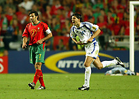 Fotball<br /> Euro 2004<br /> 04.07.2004<br /> Finale<br /> Hellas v Portugal<br /> Foto: SBI/Digitalsport<br /> NORWAY ONLY<br /> <br /> Panagiotis Fyssas of Greece celebrates the victory in front of Portugal skipper Luis Figo