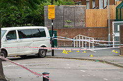 © Licensed to London News Pictures. 04/07/2020. London, UK. Evidence identification markers inside a cordon marked by police tape on Roman Way in Islington. Metropolitan Police Service officers were called at 15:20BST on Saturday, 4 July to Roman Way N7 following reports of shots fired. Officers attended with London Ambulance Service (LAS) and found a man, believed to be aged in his early 20s, suffering from gunshot injuries. Despite their best efforts, he was pronounced dead at the scene. Photo credit: Peter Manning/LNP