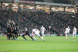 Milton Keynes Dons' Shaun Williams free kick goes over the bar - Photo mandatory by-line: Nigel Pitts-Drake/JMP - Tel: Mobile: 07966 386802 14/01/2014 - SPORT - FOOTBALL - Stadium MK - Milton Keynes - MK Dons v Wigan Athletic - FA Cup - Third Round replay