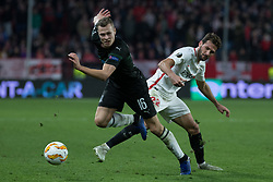 December 13, 2018 - Seville, Andalucia, Spain - Mudo Vazquez of Sevilla FC and Viktor Claesson of Krasnodar fight for the ball during the Europa League match between Sevilla FC and Krasnodar in Ramón Sánchez Pizjuán Stadium (Seville) (Credit Image: © Javier MontañO/Pacific Press via ZUMA Wire)