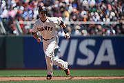 San Francisco Giants first baseman Buster Posey (28) rounds second base against the Los Angeles Dodgers at AT&T Park in San Francisco, California, on April 27, 2017. (Stan Olszewski/Special to S.F. Examiner)