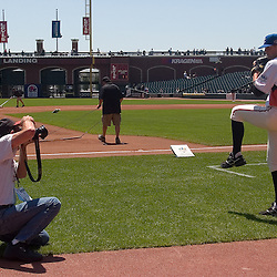 Kansas City Royals prospect Luke Hochevar (cq), #19, of the U.S. Team, poses for a photo with Major League Baseball photographer Michael Zagaris (cq) on the field before the 2007 XM All-Star Futures Game, Sunday, July 8 at AT&T Park in San Francisco...Photo by David Calvert/MLB.com
