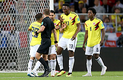 Colombia players clash with Referee Mark Geiger during the FIFA World Cup 2018, round of 16 match at the Spartak Stadium, Moscow.