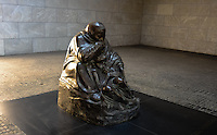 """Berlin, Germany. Käthe Kollwitz's sculpture Mother with her Dead Son in the Neue Wache building. Since 1993 the """"Central Memorial of the Federal Republic of Germany for the Victims of War and Tyranny""""."""