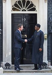 © Licensed to London News Pictures. 23/05/2015. London, UK.British Prime Minister David Cameron greets President of Nigeria, General Muhammadu Buhari, at 10 Downing Street, central London. Photo credit : Isabel Infantes/LNP