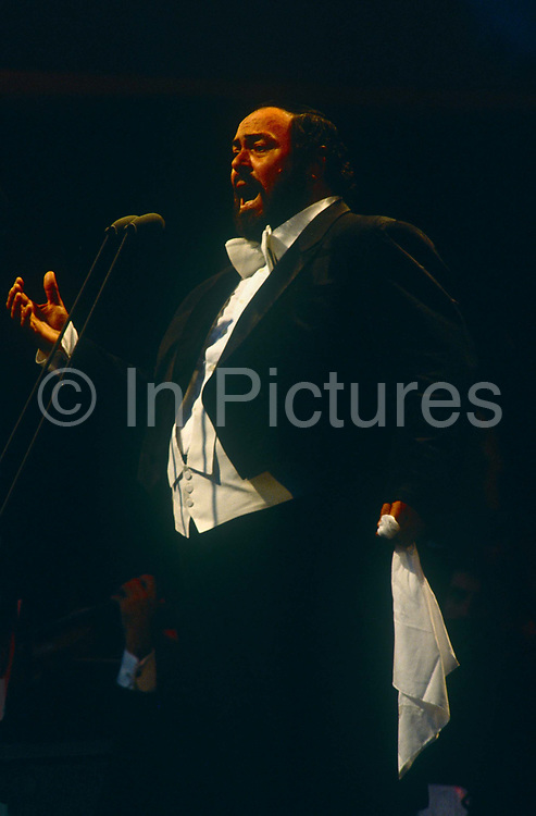 Italian operatic tenor Luciano Pavarotti performs in London during the free Party in the Park concert to celebrate his 30 years in opera<br /> on 30th July 1991 in Londons Hyde Park. A crowd of 100,000 stood in the rain to watch Pavarotti perform 20 arias by Verdi, Puccini, Bizet and Wagner. VIPs the Princess of Wales, Prime Minister John Major and Michael Caine were soaked in heavy rain along with everyone else sitting on the grass cowering beneath tarpaulins. Pavarotti helped bring an otherwise high-brow artform to the ordinary Man after the BBC used his rendition of Nessun Dorma to theme their World Cup TV coverage.