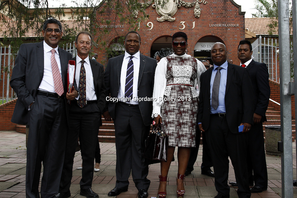 DURBAN - 31 January 2014 - Durban business woman Shauwn Mpisane appears outside the Pinetown Magistrate's Court with her husbane and legal team where the charge of interfering with a witness was withdrawn. Earlier she was acquitted of 119 fraud charges in the Durban regional court. From left are the two men who represented her in court Rafik Bhana SC and Jimmy Howse next to her husband Sbu Mpisane. Shauwn Mpisane is flanked on the right by her lawyer Phila Magwaza and slightly behind Magwaza on the right is an unnamed body guard. Picture: Allied Picture Press/APP