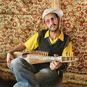 Shah Bul Masoom practices songs on his Rubab, a traditional instrument similar to a lute. He is a student of the Bulbulik music school in Gulmit village, and he's working on mixing traditional Wakhi music with modern influences.