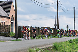 Peloton in a long line on the opening lap - Grand Prix de Dottignies 2016. A 117km road race starting and finishing in Dottignies, Belgium on April 4th 2016.