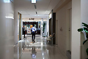 young adult man running inside a large office, shopping and restaurant building Tokyo