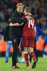 23rd August 2017 - UEFA Champions League - Play-Off (2nd Leg) - Liverpool v 1899 Hoffenheim - Liverpool manager Jurgen Klopp hugs captain Jordan Henderson after the match - Photo: Simon Stacpoole / Offside.