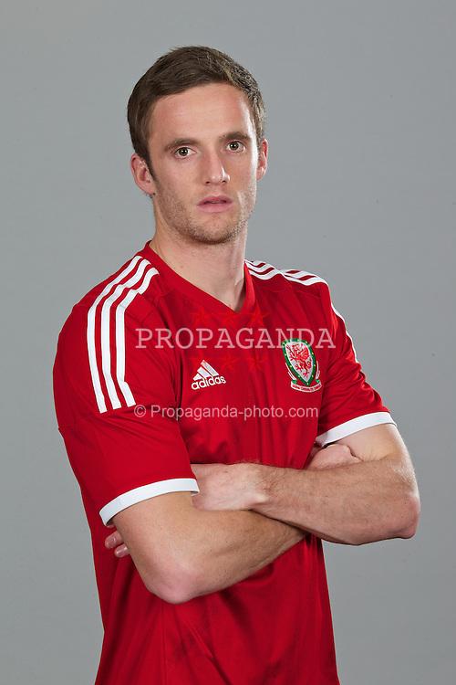 CARDIFF, WALES - Thursday, November 14, 2013: Wales' Andy King wearing the new Wales 2013/2014 Adidas home jersey. (Pic by David Rawcliffe/Propaganda)