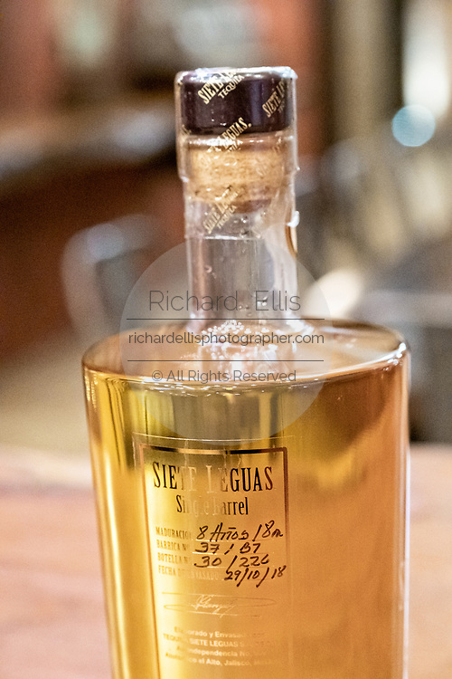 Eight year old amber tequila in the tasting room inside the Casa Siete Leguas, El Centenario tequila distillery in Atotonilco de Alto, Jalisco, Mexico. The tequila is aged from 2-12 years in white oak barrels that once held American Kentucky Bourbon. The Seven Leagues tequila distillery is the oldest family owned distillery producing authentic handcrafted tequila using traditional methods.