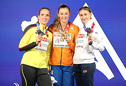 Netherland's Nadine Visser (centre), Germany's Cindy Roleder (left) and Belarus' Elvira Herman celebrate with their medals after the Women's 60m Hurdles Final during day three of the European Indoor Athletics Championships at the Emirates Arena, Glasgow.