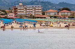 THEMENBILD - Touristen am Strand und im Meer mit Hotels, aufgenommen am 24. Juni 2018 in Viareggio, Italien // Tourists on the beach and in the sea with hotels, Viareggio, Italy on 2018/06/24. EXPA Pictures © 2018, PhotoCredit: EXPA/ JFK