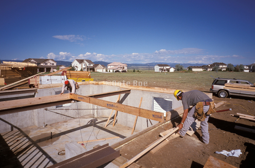 construction workers starting to build a new house. USA