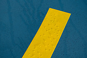Yellow stripe on a blue floor on 26th September 2021 in Roscoff, Brittany, France.