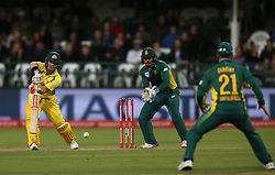 David Warner of Australia drives a delivery to JP Duminy of South Africa during the 5th ODI match between South Africa and Australia held at Newlands Stadium in Cape Town, South Africa on the 12th October  2016<br /> <br /> Photo by: Shaun Roy/ RealTime Images