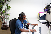 Adrienne Martin, a customer service agent, advises a student of their financial aid status for Troy University from the Greenwood Hall call center in Bryan, Texas. <br /> <br /> Greenwood Hall is a co-sourcing call center for several universities and non-profits around the country. Students, donors, and customers are unaware they are speaking with a third-party call-center employee instead of a college or non-profit employee. Greenwood Hall employs over 100 at its Bryan location and handles calls for seven universities.