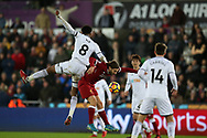 Adam Lallana of Liverpool © jumps for a header with Leroy Fer of Swansea city (8).  Premier league match, Swansea city v Liverpool at the Liberty Stadium in Swansea, South Wales on Monday 22nd January 2018. <br /> pic by  Andrew Orchard, Andrew Orchard sports photography.