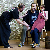 """Picture shows : Paul Riley as Fran, Greg Hemphill  as  Finlay and  Ros Sydney as Morag..Rehearsal of the forthcoming National Theatre of Scotland production 'An Appointment with The Wicker Man'..Picture © Drew Farrell  ( Tel : 07721-735041 ).On a remote Scottish island, the Loch Parry Theatre Players mount their am-dram version of The Wicker Man. When their lead actor goes missing in mysterious circumstances, they call on the services of a television cop from the mainland to step in and save their production. ..The play opens at the MacRobert Arts Centre, Stirling on 18th February 2012 before touring Aberdeen, Glasgow, Inverness and Dunfermline...The Wicker Man regularly tops """"Best Horror Film of All Time"""" lists and is regarded as a true film classic. With an unforgettable sense of creeping dread, a wonderfully memorable score by Paul Giovanni, career defining performances from Edward Woodward and Christopher Lee it also has arguably the best ending in cinema history. Now, in an affectionate new adaptation, the National Theatre of Scotland gives a gallus round of applause to this immortal chronicle of strange goings-on in a wee village. ..An Appointment with the Wicker Man features Greg Hemphill (Chewin' the Fat) and Johnny McKnight (Little Johnny's Big Gay Wedding) alongside a line-up of comic talent. It is at once a deliciously wicked homage to, and a tender celebration of, a piece of cinema history that reveals for us the spooky undercurrents lurking just below the surface of Scottish village life. ..The Loch Parry Players are messing with forces they can't possibly comprehend but at the end of the night, only one thing is for sure . . . someone's going to burn for this...Cast..Sean Biggerstaff    as       Howie and Rory.Jimmy Chisolm      as       Simon.Greg Hemphill        as     Finlay.Johnny McKnight   as      Callum.Sally Reid                 as      Marie.Paul Riley.         as      Fran.Ros Sydney              as      Morag"""