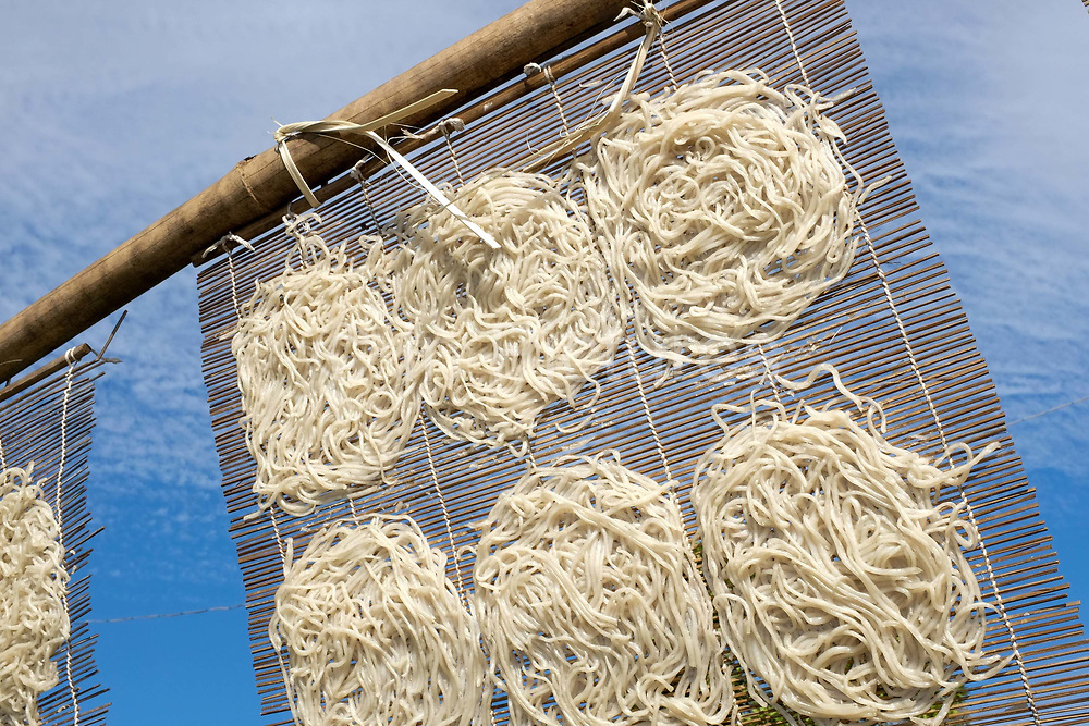 Rice noodles drying in the sun at Naung Taw village on the banks of Inle Lake on 21st January 2016 in Shan State, Myanmar
