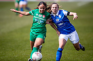 Ashlee Brown of Coventry Utd Ladies\ and Veatriki Sarris of Birmingham City Women battles for possession during the Women's FA Cup match between Birmingham City Women and Coventry United Ladies at Solihull Moors FC, Solihull, United Kingdom on 18 April 2021.