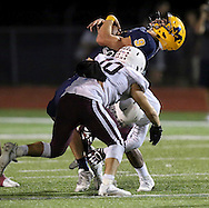 McKinney's Matthew Gadek is hit as he carries the ball during a game between McKinney High and Plano Senior High on Friday, Sept. 30, 2016 at Ron Poe Stadium in McKinney. It was McKinney High's homecoming game. McKinney won 31-28. (Photo by Kevin Bartram/buzzphotos.com