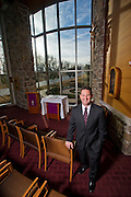 Eric Pinalto, president of Mercy Health System of Northwest Arkansas, stands in the chapel on Wednesday, Dec. 4, 2013, in Rogers, Ark. Photo by Beth Hall