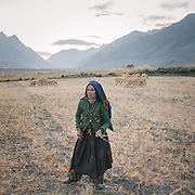 Collecting left over hay. In Sarhad village. Only foot path from here to the higher elevations. The life of the Wakhi people, in the Wakhan corridor, amongst the Pamir mountains. Trekking with Paul Salopek.