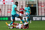 Middlesbrough midfielder Marcus Browne (12) goes down under pressure from AFC Bournemouth midfielder Jefferson Lerma (8) during the EFL Sky Bet Championship match between Middlesbrough and Bournemouth at the Riverside Stadium, Middlesbrough, England on 19 September 2020.