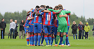 The players huddle together ahead of the U21 Professional Development League match between U21 QPR and U21 Crystal Palace at the Loftus Road Stadium, London, England on 31 August 2015. Photo by Michael Hulf.