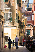Family group in street scene in Kerkyra, Corfu Town, Greece