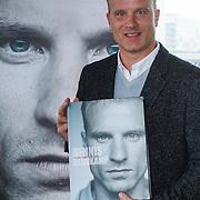 NLD/Amsterdam/20131018 - Boekpresentatie Dennis Bergkamp, Dennis met zijn boek